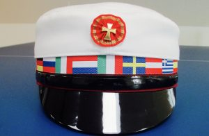 The cap with the flag band is used by the international schools.