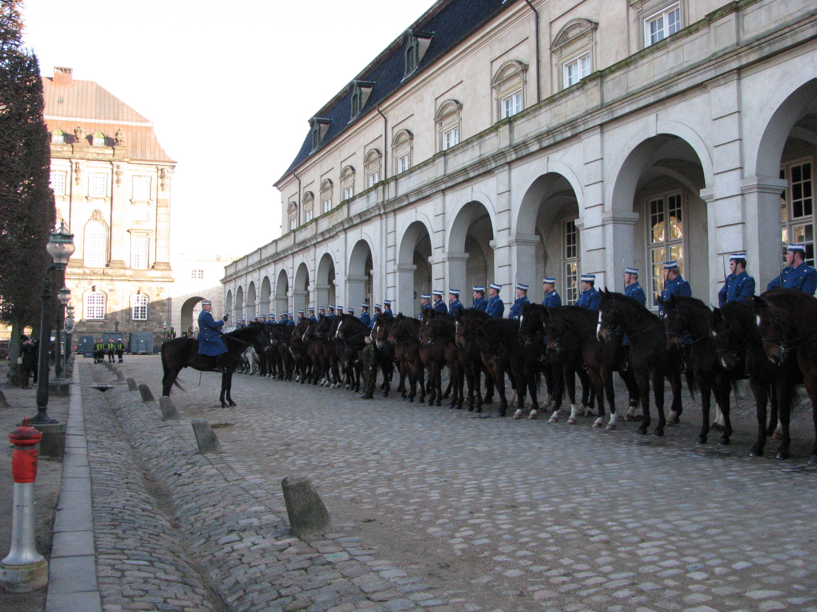 The mounted Gard Hussar Squadron in front of the Royal Stables at Christiansborg Palace. Last briefing before departure.