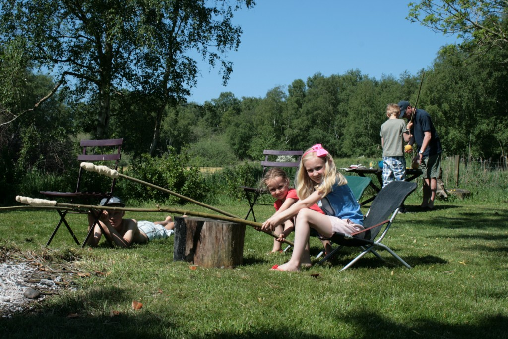 Bonfires and sno brød in the garden are a special summer house treat.